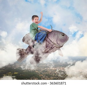 A little boy is riding a fish in the sky with a city below and clouds for an imagination, happiness or freedom concept.