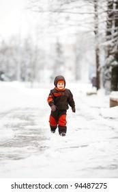 little boy runs in park