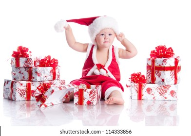 Little boy Santa Claus with Christmas gifts on a white background