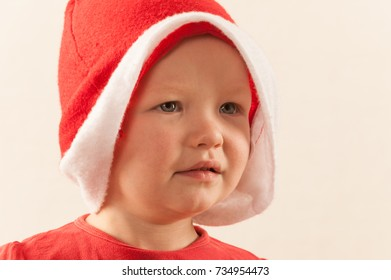 Little boy in Santa Claus costume. Emotions. Preparing for Christmas.