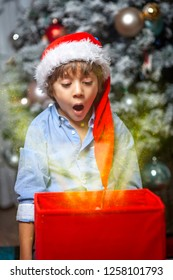 A little boy with a Santa Claus hat and a magic dust