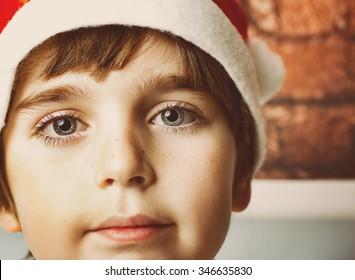Little boy in santa's hat  ready for festive christmas time