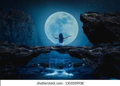 The little boy sat on his stone bridge on the night of the full moon.