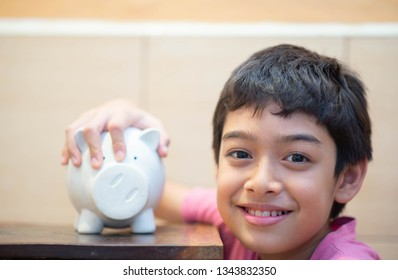 Little boy save money in piggy bank