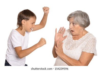 Little boy is scaring his grandmother isolated on white