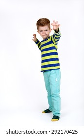 Little boy scaring somebody with his hands isolated