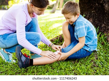 Little boy scraped his leg while playing