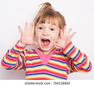 Little boy screaming with his arms up. 5 years old girl surprised with open mouth and hands near her hands