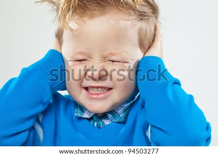 Little boy screaming with his eyes closed, isolated on white background