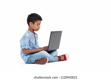 Little boy search and learning education with laptop , he feel fun and happy