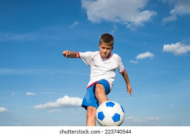 Little Boy Shooting at Goal
