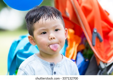 Little boy showing his tongue
