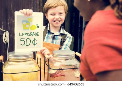 Little Boy Showing Lemonade Price at Food Stall Market