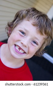 little boy showing off his lost tooth