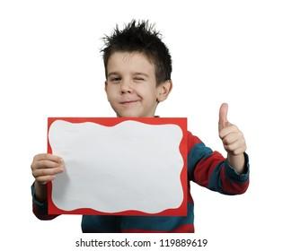 Little boy showing okay symbol. Holding white board.