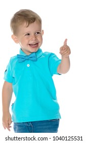 Little boy is showing one finger. Portrait of a cute boy on a white background. A beautiful little guy.