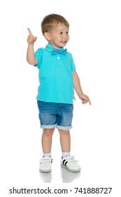 Little boy is showing one finger. Portrait of a cute boy on a white background. A beautiful little guy.