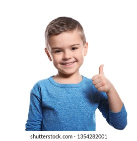 Little boy showing THUMB UP gesture in sign language on white background