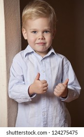 Little boy showing thumbs up gesture