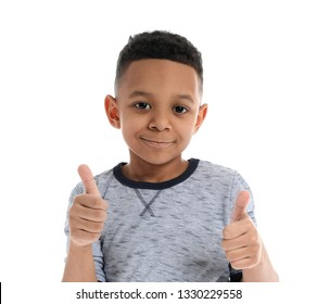 Little boy showing thumb-up gesture on white background. Concept of speech therapy
