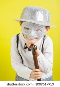 little boy with silver carnival mask