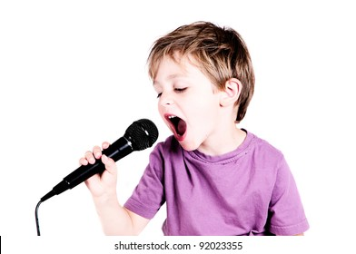 little boy singing through a microphone