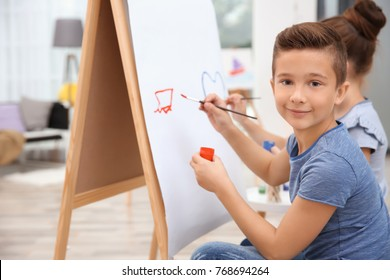 Little boy with sister painting at home