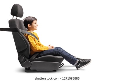 Little boy sitting in a car seat strapped up isolated on white background