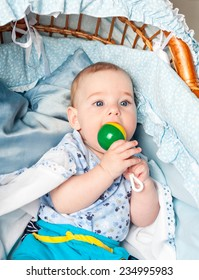 Little boy sitting in cradle with beanbag