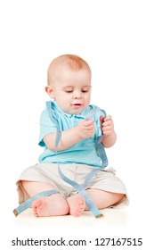 Little boy sitting with a measuring meter