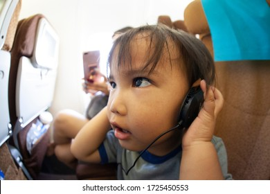 little boy sitting on the airplane