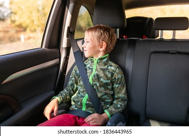 Little boy sitting on a booster seat buckled up in the car. Children's Car Seat Safety