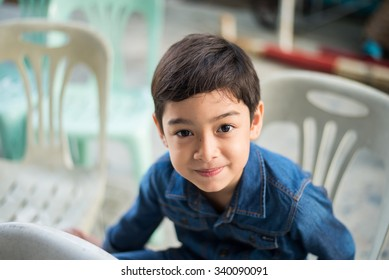 Little boy sitting on the chair
