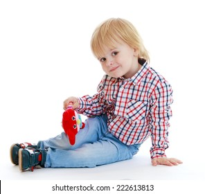Little boy sitting on the floor teddybear .Childhood education development in the Montessori school concept. Isolated on white background.