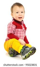 The little boy sitting on a floor.