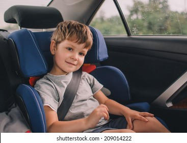 little boy sitting in safety car seat