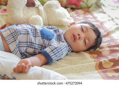 little boy sleeping in his bed.