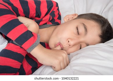 Little boy sleeping with thumb in the mouth
