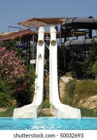 little boy sliding down big kamikaze water slide