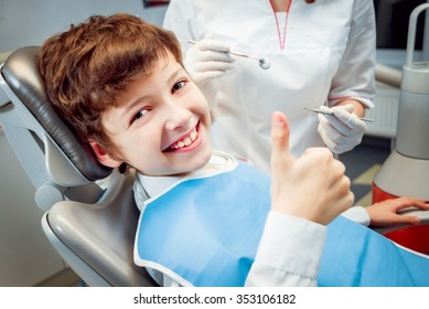 Little boy smiling in the dental office.