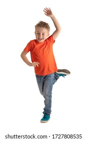 LITTLE BOY SMILING HAPPY WHILE BALANCING ON ONE LEG WITH ONE HAND UP ISOLATED ON WHITE BACKGROUND, HAPPY ACTIVE KID