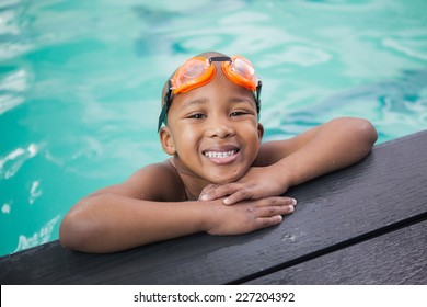Little boy smiling in the pool at the leisure center