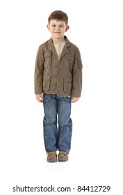 Little boy smiling, wearing autumn clothes.?