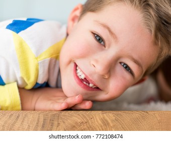 Little boy smiling withouth his milk teeth