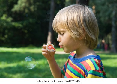 Little boy with soap bubbles, outdoor shot
