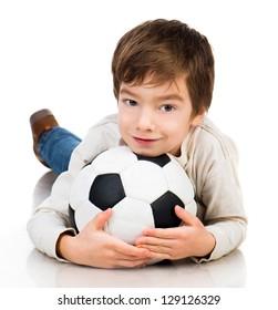 Little boy soccer ball lying on white floor