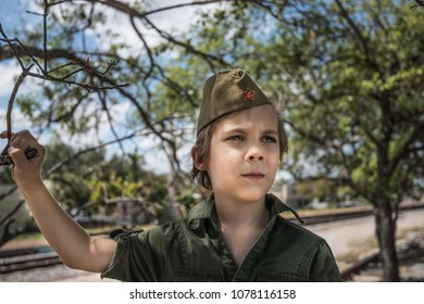 Little boy in soviet union Russian red army forage-cap and khaki shirt