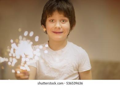 a little boy with sparkler