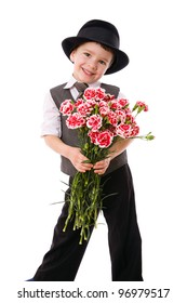 Little boy standing with a bouquet of pink carnations, isolated on white