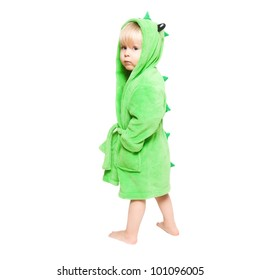 The little boy standing in green dressing gown like dragon
